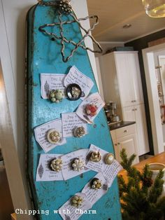 Junk styled advent calendar on an ironing board by Chipping with Charm. #12days72ideas
