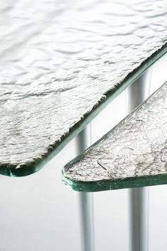Design: Massimiliano Locatelli Collection of high tables, consoles and low tables with soft irregular shape, rounded edge and elegant thin legs in blown glass.The different pieces, available independently from each other, if put close together, can create a table of large dimensions. With top in a special poured silvered glass. The legs are always in the same finish of the top.*Attention, the table tops in poured glass show evident irregularities, and structural and chromatic differences… Glass Furniture, Furniture Styles, Table Furniture, Furniture Design, Metal Texture, Glass Texture, Glass Table, A Table, Console Table