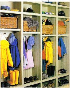 Adjustable shelves for each kid just outside the garage door!