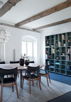 Large bookshelf in a light blue/green colour - plenty of room for books and items to display. Designed by Mogens Koch.