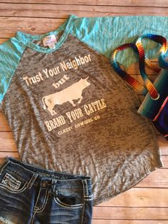 Trust your neighbor, but brand your cattle t shirt. Custom T by Classy Cowgirl Co. Baseball burnout is great year round. Runs true to size ( ladies sizing) Small-2-4, med 6-8, large 10-12, Xlarge 14-1
