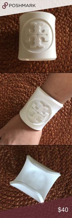 💯% Authentic Tory Burch White Cuff Bracelet This is a beautiful authentic Tory Burch white plastic cuff bracelet. Great condition- barely ever worn! Tory Burch Jewelry Bracelets