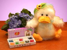"Quacky Easter Duckling    Your little bunnies will quack up with laughter when this little duckling arrives and quacks her song. She sings ""You Are My Sunshine"" while flapping her wings.    She is accompanied by Jelly Belly's 10 most popular flavors      Visit: http://forever.labellabaskets.com"