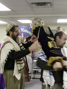 This is what's known as Simchat Torah, or The Rejoicing of the Law. Lots of Dancing, Lots of SIMCHA! (JOY)