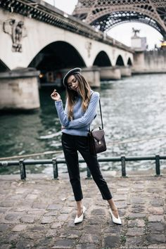 Fashion blogger Beatrice Gutu wearing cashmere baby blue turtleneck with leather pants and Celine v neck shoes parisian style outfit with eiffel tower