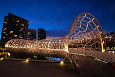 Webb Bridge (2005) – Melbourne, Australia. One of the many bridges that cross the Yarra River, Webb Bridge is located on the southern end of the Docklands and resembles the fishing baskets and traps used by the native people. Designed by architect Denton Corker Marshall in collaboration with artist Robert Orwen, it was constructed using materials recycled from the previous bridge, the Webb Dock Rail Bridge.