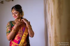 A classic red saree, complimented by heavily worked green bridal blouse, further accentuated by sparkling kemp jewellery, along with subtle yet elegant makeup & hair-do! What more do we need for a bride to be beautiful?! Here's a classy bridal photo shoot that we came across.  Saree & Blouse -Mabyo Fashions  Makeup - Preet...