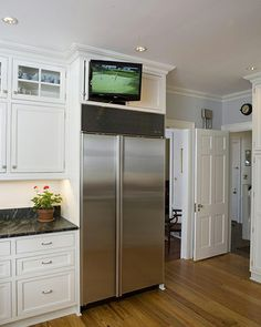 Built Ins Frame The Kitchen Appliances And Provide A Great Spot For Hiding  A Television
