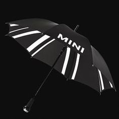 Umbrella Walking Stick - Black aluminum frame, with black polyester silk canopy. Outside with printed MINI wordmark logo in white. Interior with Black Jack design. Metal, plastic and leather handle, echoing the original MINI gearshift lever design. Diameter: 41¼-, length: 33½-. Imported. http://www.shopminiusa.com/PRODUCT/872/UMBRELLA-WALKING-STICK/?CenterId=6577501
