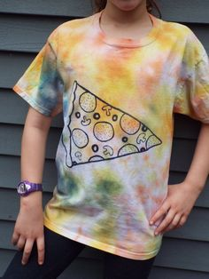 This unique tie-dye shirt would make the perfect gift for any young pizza lover. It is tie dyed by hand with a dappled pattern of mostly oranges and yellows and has a large, yummy slice of pizza hand-inked on the front. From Anything on a Tie Dye at Creations by Maris https://www.etsy.com/listing/271305135/kids-pizza-shirt-youth-l-pizza-lovers