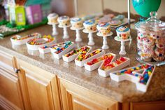 Child's name spelled out with candy dishes.  Cute.