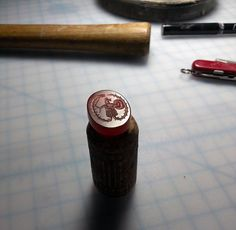 I custom engrave the intaglio design of your choice, within reason and the limits of my ability. A wide variety of materials may be acquired. Here is a list of them, including color, cost and level of detail possible according to the hardness of the stone when carving. A star (*) indicates a traditionally common material in ancient intaglio gems.  Color // Stone // Cost // Detail  TIER I  Red ------ Agate ---------- $ - Very Good * Blue ----- Lapis Lazuli --- $ -...