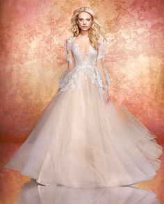 There is something so dreamy about Hayley Paige's latest collection. This dress is something straight out of a fairytale! | WedLuxe Magazine | #WedLuxe #Wedding #luxury #weddinginspiration #luxurywedding #weddinggown #weddingdress #fashion #hayleypaige