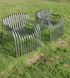Julian Mayor A pair of Contour chairs, 2000 Steel Being sold on behalf of the Cass Foundation Being offered at auction on 20 May 2014, lot 106