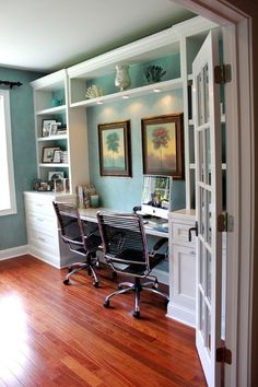 I like built ins for the office. Lots of storage without being an eyesore. I like the idea of a white desk and work area and the blue on the walls is very pretty.