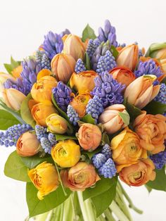 How to Arrange a Spring Bouquet -   This hand-tied bouquet of vibrant flowers is made up of contrasting blues and oranges that enhance each other so the blooms sing with intensity. It looks sensational in an orange or black glass vase as a table centerpiece.