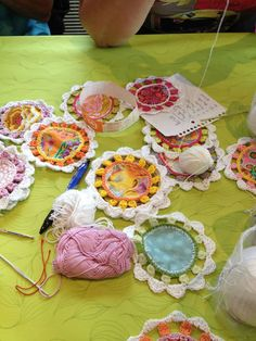 Crochet around fabric circles (could be squares or other shapes, too) and then connect the motifs together for a blanket or placemat.