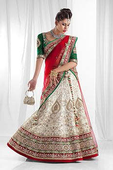 Pure rawsilk ghagra and blouse with net dupatta embellished with thread, pearl, gota and zardozi work