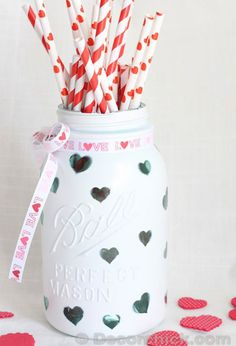 Small heart stickers and glossy white paint are all you need to turn a jar into an adorable pencil holder or vase (perfect for teachers!).