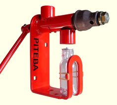 oil expeller, get oil from oil seeds and nuts (piteba.com).  man, i want one.  This is so cool! :)