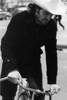 Vincent Gallo riding a bicycle