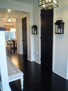 Just beachy paints her doors black satin and sprays bronze door knobs with spray paint.