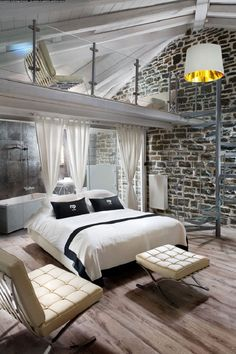 Bedroom - exposed brick wall, spiral staircase and loft.