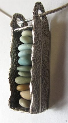 Pebblestack Pendant. idea - glass beads, free form, beach glass, beach stone. build sterling silver frame.