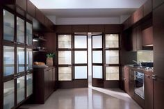 glass breaks up the cabinetry so you are not overwhelmed - esp. like the balance of this