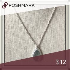 "Light Blue Glass Teardrop Pendant This light blue transparent glass teardrop pendant is surrounded by tiny crystals in silver tone suspended on a silver tone 16"" chain. Pendant measures 1.25""x 0.75."" Jewelry Necklaces"
