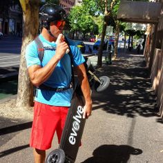 Man charging electric #skateboard with mission