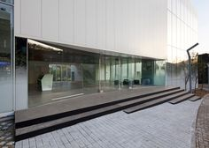 White Block Gallery by SsD features fritted glass facades