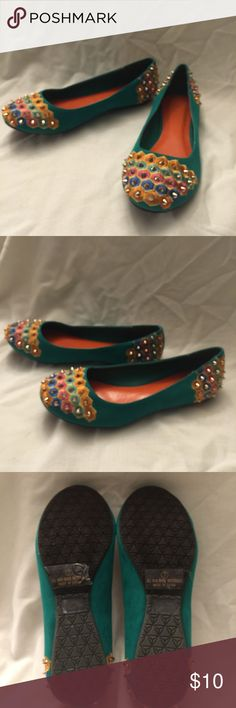 Green Flats with Multi colors and gold spikes NWOT These are totally flats . No heels with approx 1/4 inch sole . Has multi color on toes and heels with gold colored spikes. Has orange liner inside shoes . liliana  Shoes Flats & Loafers