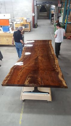 Finishing up a big Claro Walnut slab for Dorset Custom Furniture. long, inches thick and wide at the crotch. Standing on inch thick water jet cut steel legs. Shipping from Vermont to Hawaii. Walnut Slab, Walnut Table, Wood Slab, Wood Table, Table Legs, Custom Furniture, Wood Furniture, Furniture Ideas, Woodworking As A Hobby