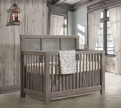We know you'll love this rustic and elegant nursery for your baby boy or baby girl featuring Liz and Roo's baby bedding!