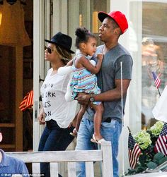 Family day out: Beyonce and Jay-Z took daughter Blue Ivy clothes shopping on Tuesday in The Hamptons, where Kim Kardashian is currently filming her reality show