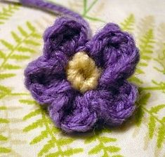 Using this flower on a strawberry afghan for a doll's cradle