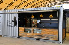 Goodman Hungry Bear Cafe container bar created by Price and Speed. A 20 foot shipping container has been modified into a functional cafe