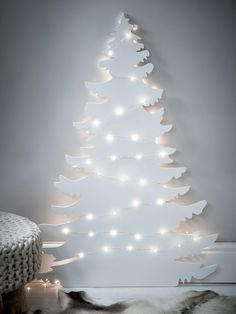 """Genius Christmas Tree Alternatives For Small Spaces #refinery29 http://www.refinery29.uk/christmas-tree-alternatives-for-small-spaces#slide-5 There may not be a pine needle in sight but there's still plenty of magic in the air, thanks to this tree silhouette. Festoon with fairy lights to create a winter wonderland of your very own. Now there's no danger of Santa not stopping by.Cox & Cox Tree Silhouette Wall Art, £85, available at <a href=""""http://www.coxandcox.co.uk/tree-silhouette-wall..."""