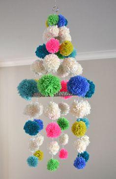 DIY pom pom chandelier - how cute for a focal piece!