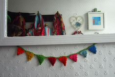 Mini Crochet Bunting. Cute and a good way to use up all of my embroidery floss!