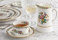 Gold-edged Ming Rose china from Coalport with La Scala stemware from Gorham Crystal.