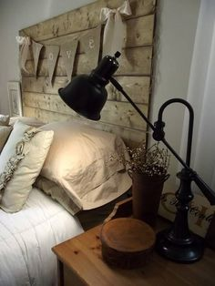 2 Things~ Great idea of the wooden headboard (love it!) but I also love the burlap banner hanging across the headboard. I think it would be a cute thing to do in a kids bedroom with letters in their name on the banner.