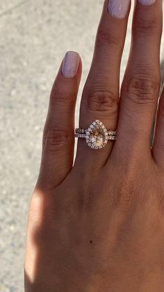 This pear shaped morganite ring in rose gold is a true beauty. Dazzling diamonds surround the center stone on the halo and set half way down the shank, enhancing the beauty of this morganite halo ring. Wear this halo ring alone or stack it with other ring Pink Diamond Engagement Ring, Vintage Engagement Rings, Halo Diamond, Solitaire Engagement, Diamond Rings, Stackable Wedding Bands, Wedding Ring Bands, Love Ring, Dream Ring