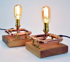 A Pair - Industrial Copper Pipe - Table Lamps - Bedside Lights - Reclaimed Oak Blocks by lhirondellechic on Etsy Copper Lamps, Copper Lighting, Copper Pipes, Brass Pipe, Brass Fittings, Bedside Lighting, Bedside Table Lamps, Copper Candle Holders, Copper Crafts