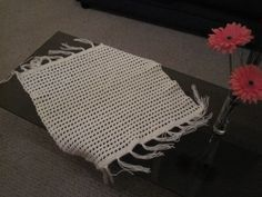 Cream baby blanket or pram rug. Hand crochet available at www.woollygoods.com