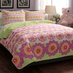 Dress up any room in bright color with this refreshing floral quilt set. Decorated with pink, green and yellow flowers, this machine washable quilt is created with soft cotton to bring both style and comfort to any bedroom decor.