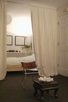 Curtained bed.  don't forget details like art and paper lantern!
