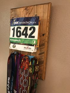 Race Bib & Medal holder made from reclaimed wood. This imperfectly perfect item is the perfect way to display all of your hard work and dedication from your 5k fun run to your latest Ultra.