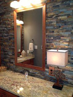 Elegantly rustic master bathroom with dry stacked stone backsplash